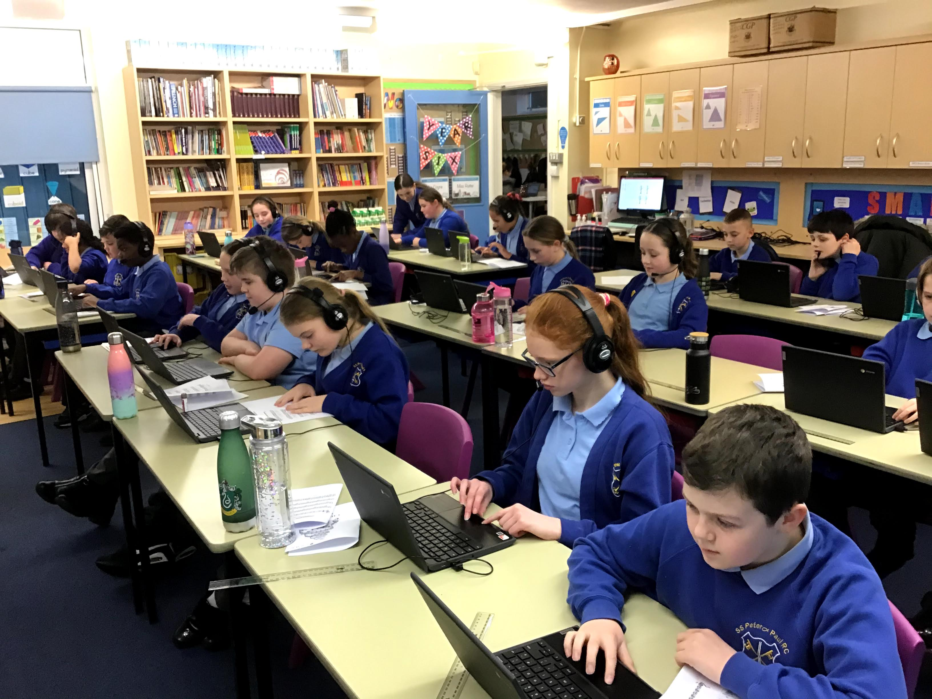 School children on laptops