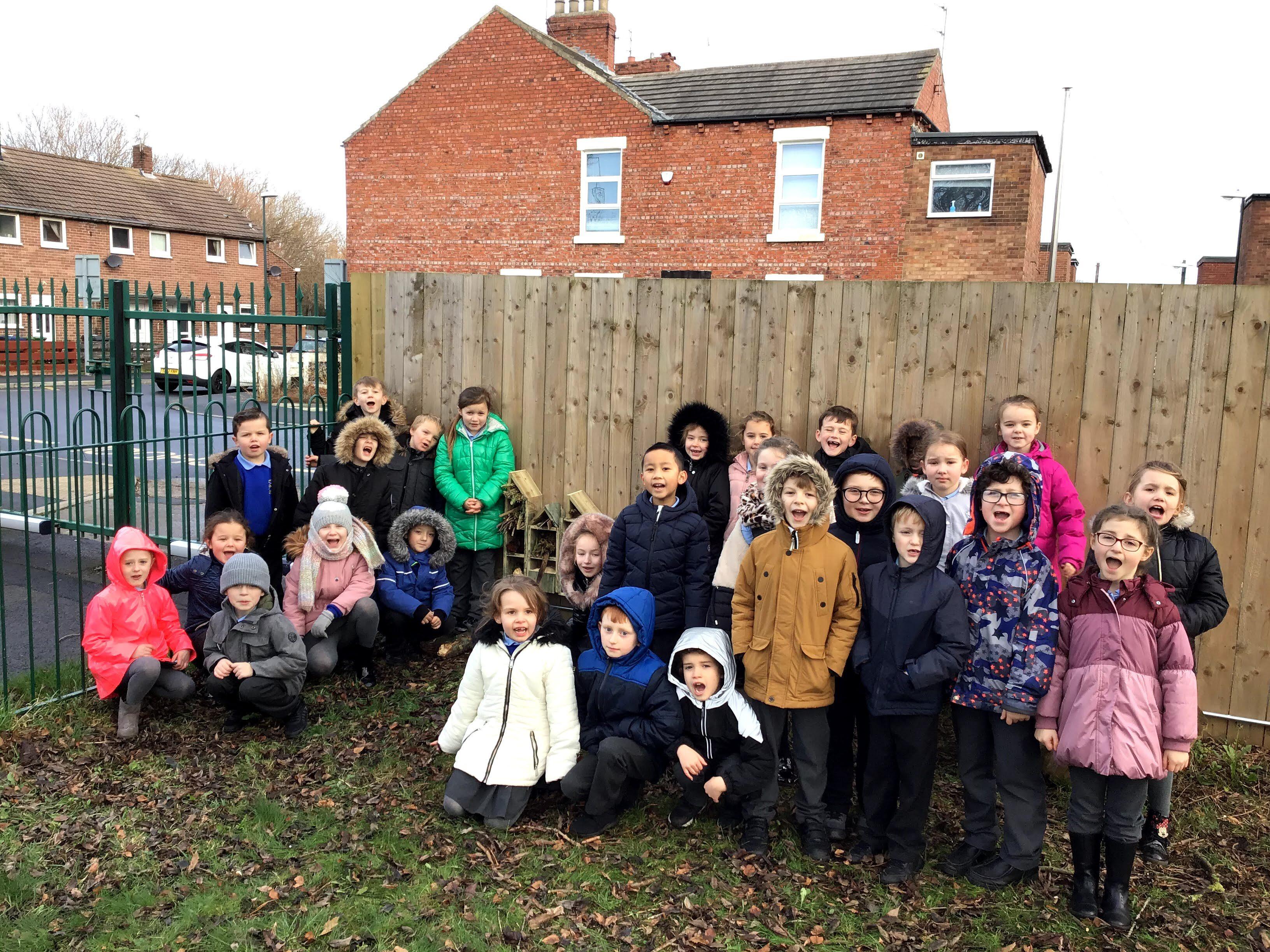 School children outside in winter coats